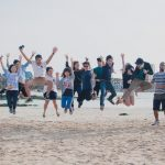 Korean Language Flagship capstone students jumping at the beach in Jeju-do, South Korea