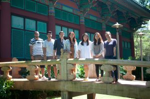 Seven Korean Language Flagship Center MA Cohort 7 students standing on a bridge at the Center for Korean Studies at the University of Hawaii at Manoa.